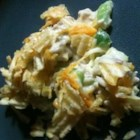 Hot Chicken Salad -  This chicken in this recipe is keeping some pretty fine company. Lots of color  - green pepper and pimento. Lots of crunch  - potato chips and almonds. And then there 's the cheese and creamy mayonnaise. Serves twelve.
