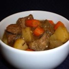 Beer-Baked Irish Beef - Irish-inspired beef stew cooks up fully flavored and hearty when seared in herb seasoned flour and slow cooked with carrots, onions, bacon, and Irish stout beer.