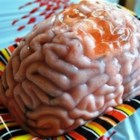Pink Brain Shooter - A pinkish-white brain with painted veins, made of peach gelatin and peach schnapps, makes the creepiest shooter ever.