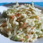 Coleslaw I - Two nice surprises in this slaw that zip up the taste a bit  - shredded carrots and dry onion flakes. This recipe makes a bunch  - enough for twelve  - and is a snap to double or triple, if you 're inviting a crowd.