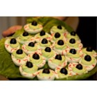 Halloween Eye of Newt - Bubble, bubble. Toil and trouble.  This appetizer is commonly known and used but, I have put my own little twist on this recipe. It is deviled eggs made to look like the eyeballs of a lizard. It a hit with the kids at my Halloween party.
