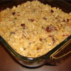 Cheesy  Potato Casserole - Hash brown potatoes are baked with processed cheese, mayonnaise and onion, topped with real bacon bits.