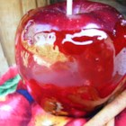 Candied Apples III - Melted cinnamon red hot candies form the hard coating for apples on sticks.