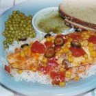 Tilapia with Tomatoes, Black Olives and Corn - Easy to make, and beautiful on the plate. This tilapia is cooked in the tomato sauce it is served with. The tomato sauce is made with diced tomatoes, garlic, corn, and black olives.