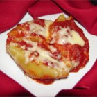 Chicken and Cheese Stuffed Jumbo Shells - Jumbo pasta shells stuffed with chicken and cheese, and baked in tomato sauce.