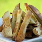 Oven Fries - Couldn't be simpler or more tasty. Cut potatoes are coated with oil, sugar, salt and red pepper flakes, and then baked. They emerge crusty and nippy on the outside and all potato on the inside.