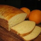 Orange Bread - Here's a tangy citrus delight.  It turns out a light orange color loaf with a delicate orange flavor.