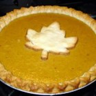 Homemade Fresh Pumpkin Pie - Chunks of pumpkin are boiled on the stove and then mashed with evaporated milk, sugar, eggs, and spices to create the filling for a shortening based crust in this delectably rustic Thanksgiving classic.