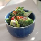 Alyson's Broccoli Salad - Bacon adds a little saltiness to this broccoli salad recipe made with sunflower seeds, red onion, and raisins.