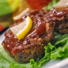 Lemon Barbeque Meatloaf - Delicious individual meatloaves! The flavors are great and the topping is to die for. The lemon on top makes a nice presentation.