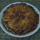 Cranberry Pear Upside-Down Cake - Nut-studded caramel tops sliced pears and cranberry cake in this upside-down cake, which can be served plain or with a scoop of vanilla ice cream.
