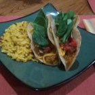 Spaghetti Squash Tacos - Spaghetti squash seasoned with onion, jalapeno pepper, and taco seasoning makes a great meat-free alternative for taco night.