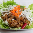 Asian Lettuce Wraps - Tangy, marinated beef is wrapped in refreshing lettuce leaves in this quick and easy Asian lettuce wrap recipe.