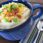 Baked Potato Soup V - A whole lot of potatoes are baked then combined with whole milk, bacon bits, sour cream and Cheddar cheese in this thick soup.