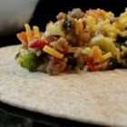 Southwest Breakfast Burritos - You'll never buy frozen breakfast burritos again! Loaded with sausage, eggs, and cheese, you can squeeze in a great meal even on your busiest morning.