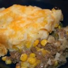 American Shepherd's Pie - Ground beef and onions seasoned with thyme and made creamy with vegetable soup are smothered in mashed potatoes, topped with Colby cheese and baked for a hot, hearty dinner.