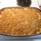 Holly's Chicken Cordon Bleu Casserole - A big melty, cheesy casserole is crammed full of Swiss cheese, chicken, mushrooms, and diced ham, all layered with a buttery corn flake topping.