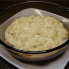 Party Potatoes - In this recipe for make-ahead mashed potatoes, cream cheese, sour cream and butter combine to make this rich and delicious casserole perfect to serve along side meat, poultry or fish.