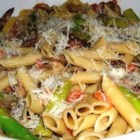 Penne with Asparagus and Mushrooms - Fresh sauteed vegetables are combined with a fresh creamy tomato sauce to create this delicious, easy to make pasta dish. Serve with grated cheese.