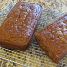 Persimmon Bread I - Reminiscent of apricots and honey, persimmons make a lovely bread when gently spiced with cinnamon, and augmented with raisins and chopped walnuts.