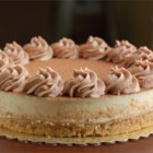 Tiramisu Cheesecake - With a crust made of ladyfinger crumbs and a filling made with cream cheese, mascarpone, and espresso, this cheesecake combines the flavors of tiramisu with the richness of a New York-style cheesecake. Top with grated semisweet chocolate just before serving.