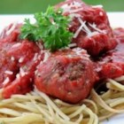 Italian Spaghetti Sauce with Meatballs - Big, tasty beef meatballs are simmered in an easy Italian tomato sauce in this easy recipe.