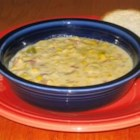 Slow Cooker Corn Chowder - A can of evaporated milk finishes this recipe for corn chowder with ham, onion, celery and potato in a chicken bouillon soup base.  Allow 8 hours cooking time.