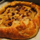 Apple-Cranberry Crostada - While a good pie crust ought to be a part of every cook's repertoire, sometimes there just isn't the time. But why leave the baking to the grocery stores or bakery when puff pastry is a simple, high-quality stand-in for the original? In this Crostada, the sheet dough is baked free-form with ingredients piled on top. Couldn't be easier!