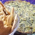 Hot Spinach and Artichoke Dip - Spinach, artichoke hearts, crumbled bacon, and Parmesan flavor this crowd-pleasing dip.