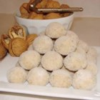 Walnut Balls - This is an old, old recipe that has been in  the family for years.  The origin is   unknown.  Recipe uses very little sugar in it  and is rolled in superfine sugar to sweeten.