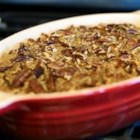 Yummy Sweet Potato Casserole - A delicious mashed sweet potato casserole with a crunchy pecan topping. Easy to make-ahead, this recipe bakes in only 30 minutes.