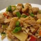 Chinese Chicken Fried Rice I - Chicken stir-fried with a colorful array of vegetables and a bounty of rice with a scramble of eggs running throughout.
