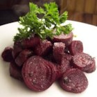 Roasted Pesto Beets - Red beets are boiled until just tender,then sliced and smothered in pesto before being roasted in the oven.