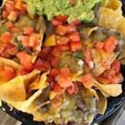 Steven's Baked Nachos - Here's one man's interpretation of always-popular nachos. Layered tortilla chips, grated Jack cheese, shredded chicken, refried beans, and sour cream are baked to perfection in a tasty appetizer guaranteed to please friends and family.