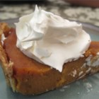 "Pumpkin Pie - This is the only pumpkin pie recipe I've ever used. It's been in the family for at least sixty years! Since, in our family, one pie is never enough, I like to triple the filling recipe and divide it into two pie shells, since, as my Mom always says, ""No body likes a skimpy pie!""  (Of course, this will add a few minutes to the baking time, too.) Originally submitted to ThanksgivingRecipe.com."