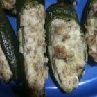 Kickin Stuffed Peppers - Tired of boring stuffed green peppers? Try these baked jalapenos with a delicious cream cheese filling full of flavor! They are great as an appetizer or side.