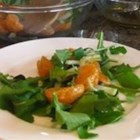 Arugula Salad with Citrus Vinaigrette - Freshly squeezed citrus juices and olive oil create a deliciously light salad dressing for this simple green salad made with arugula, pear, and red bell pepper.