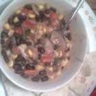 Vegetarian Black Bean Chili - An interesting meatless chili involving an array of spices and vegetables. Adjust the spicy seasonings to make it as hot as you like!