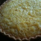 Pineapple Coconut Chess Pie - A delicious chess pie with the tropical flavors of pineapple and coconut.