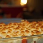 Candied Yams - Canned yams are glazed with butter and brown sugar, topped with marshmallow, and baked in this satisfying Thanksgiving classic.