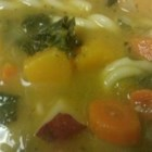 Butternut Vegetable Soup - A thick, creamy butternut and bean soup is loaded with colorful, tasty vegetables - potatoes, onion, carrots, and and kale. Serve with crusty bread.