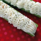 Grandma's Stuffed Celery - Anyone can make this simple, old-fashioned, and tasty appetizer of celery sticks stuffed with a cream cheese and green olive filling. The green celery and olives with red pimiento pieces look pretty on an appetizer tray, too.