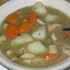 Potato Chicken Stew - A stew full of not only chicken and potatoes but carrots, onion, mushrooms, mixed veggies and a smattering of herbs and spices. It is fine to substitute chicken broth for chicken stock, simply adjust the salt content.