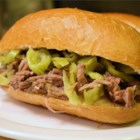 Pepperoncini Beef - Roast beef cooked in a slow cooker with garlic and pepperoncini makes a delicious and simple filling for sandwiches. Serve on hoagie rolls with provolone or mozzarella cheese and your favorite condiments.