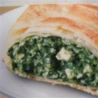 Spinach Strudels - These light, crispy phyllo pastry roll-ups are filled with spinach, breadcrumbs, and feta cheese. Best served warm out of oven.