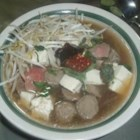 Vietnamese Beef Pho - Paper-thin slices of top round or sirloin are cooked along with rice noodles in individual serving bowls into which hot beef broth fragrant with lemon grass, ginger, and cinnamon is poured.