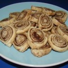 Piggies (Sugar and Cinnamon Pie Dough Cookies) - Pie crust is rolled out, sprinkled with cinnamon and sugar, and rolled into a log to be sliced into little cookies that bake up fast.