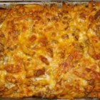 Chicken and Chorizo Pasta Bake - Not a recipe for people on a diet - chicken, sausage, and penne is baked in a creamy tomato sauce.  I cook the meats, pasta, and sauce all at the same time, but it can be done individually and refrigerated before baking it in the oven.