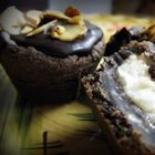 Almond Chocolate Coconut Cups - A chocolate fudge cake crust, marshmallow coconut center and chocolate almond topping in a mini-muffin cup.
