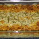 Green Bean Casserole III - Canned green beans are mixed with cream of mushroom soup and milk, and baked topped with crispy French fried onions in this classic American side dish.